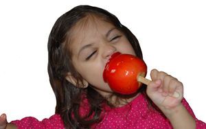 eating candy apple